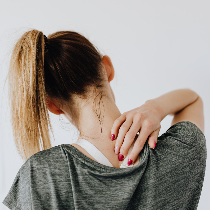 woman feeling pain in neck, pain management jonesboro ar