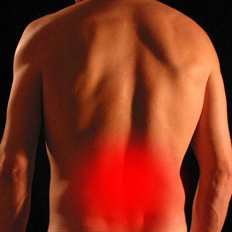 man with lower back pain from sciatica
